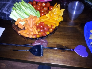Who does think riding crops belong next to the snacks at a party?