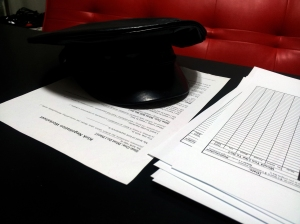 Some paperwork and my Domme hat