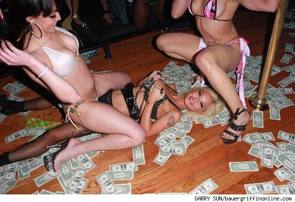 people having sex in a strip club