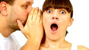 stock-footage-man-telling-a-secret-to-a-surpirsed-girl