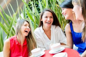 16848434-Group-of-girls-having-a-coffee-and-talking-Stock-Photo-women-talking-friends